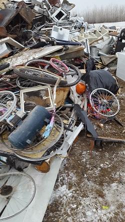 Waste in metal pile