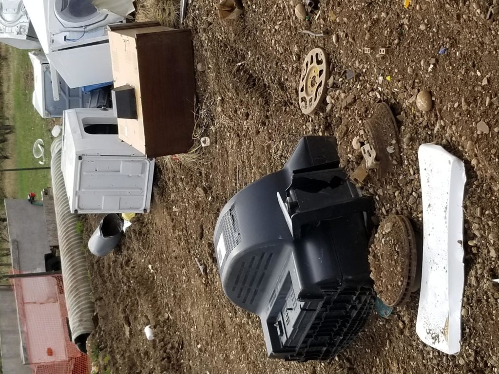 TV's in metal pile